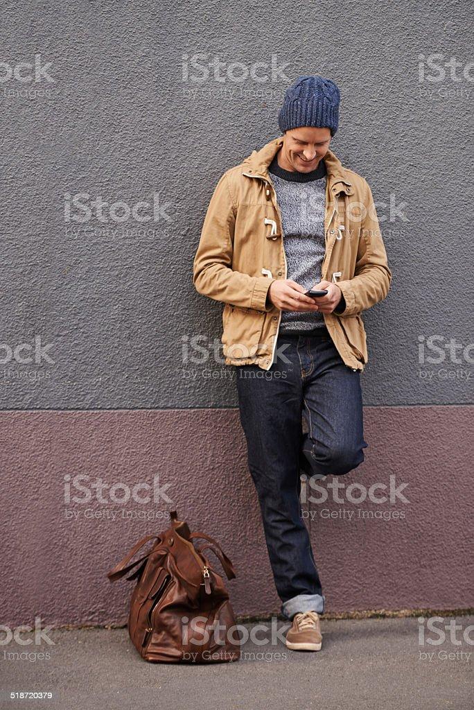 I'm in the city, wanna meet? stock photo