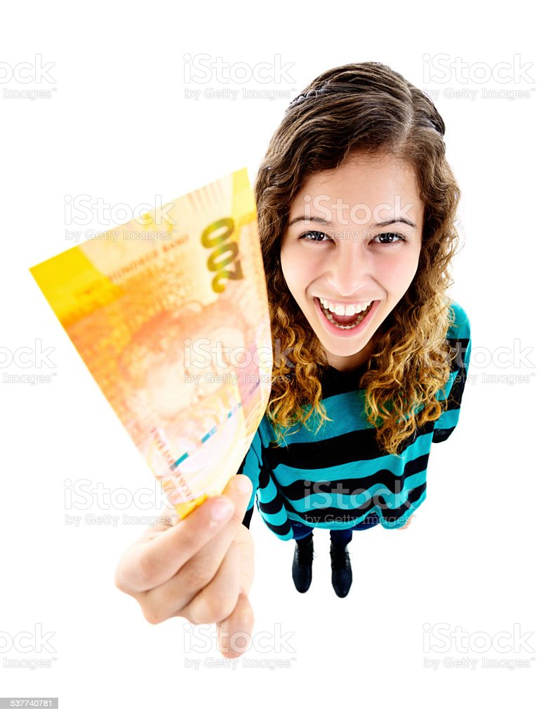 I'm rich! Smiling young woman holds Two Hundred Rand banknote stock photo