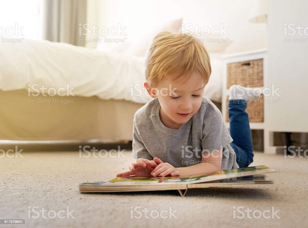 I'm slowly learning to read all the big words now stock photo