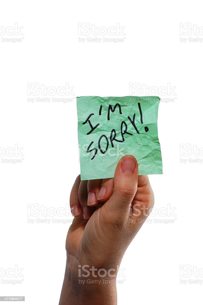 I'm Sorry - Note in Hand 1 royalty-free stock photo
