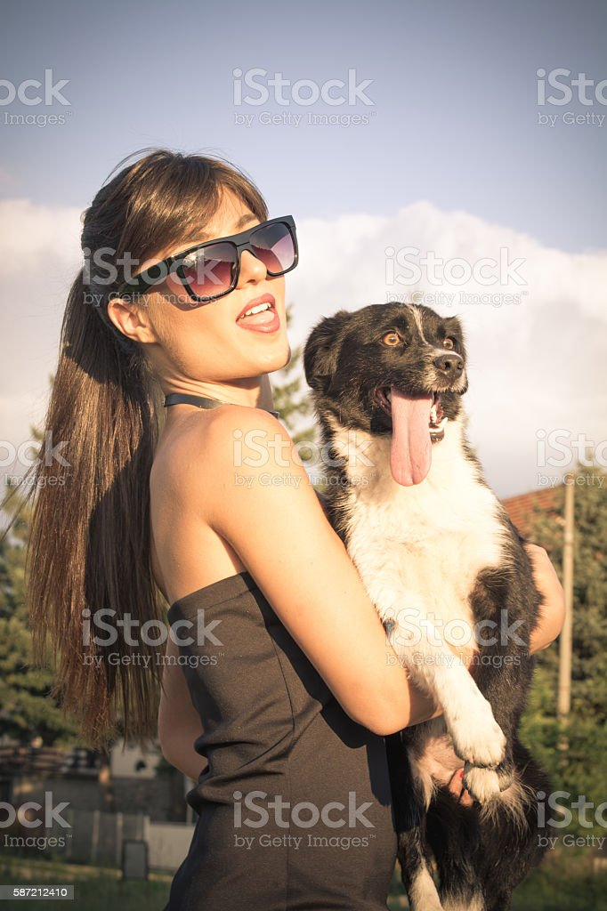 I'm talking softly and carrying a dog with itself stock photo