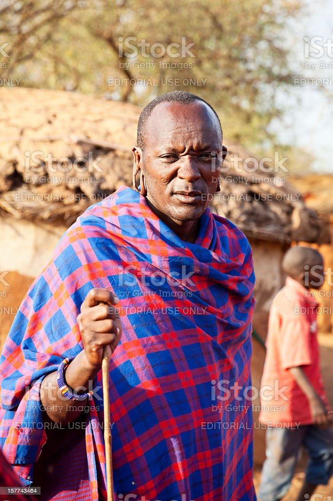 Maasai elder outside his hut stock photo
