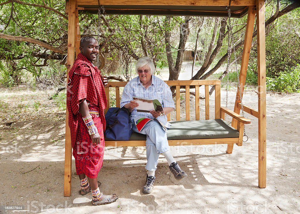 Maasai guide with tourist in swing, Kenya, Africa stock photo