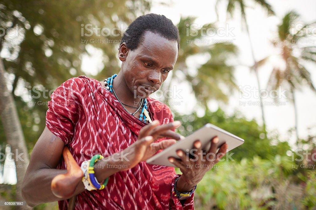 Maasai nomadic man using technology stock photo