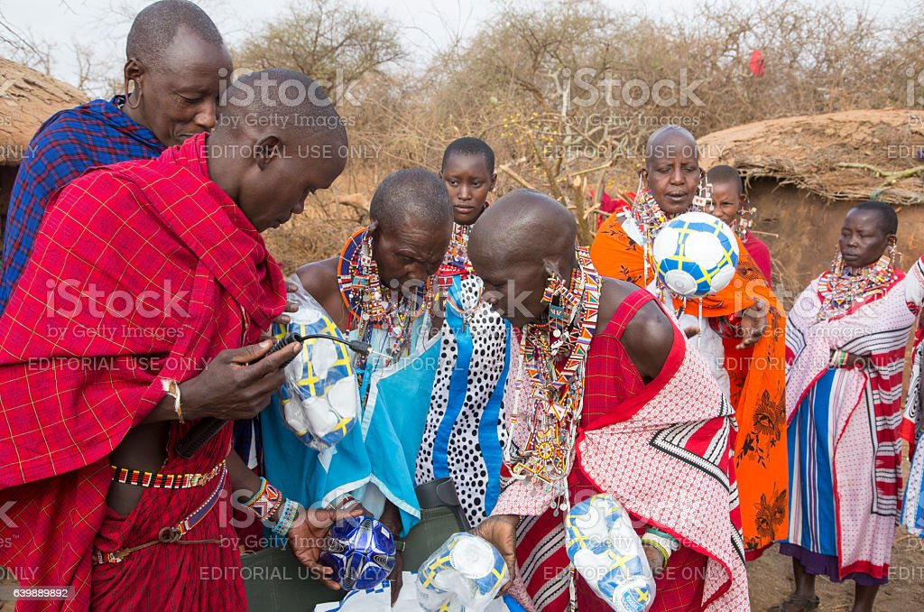Maasai people in village in Kenya. Football (soccer). stock photo