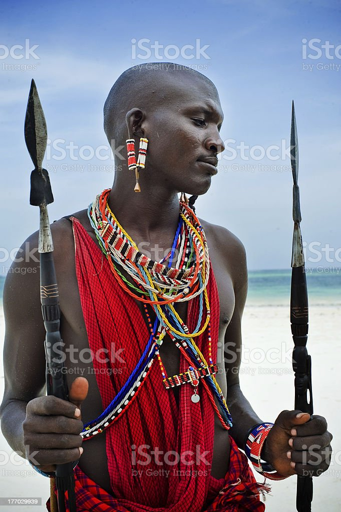 Maasai sitting by the ocean stock photo