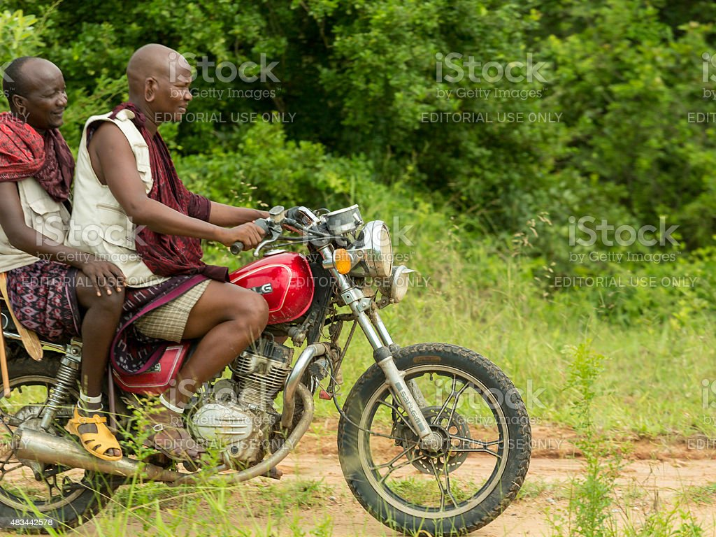 Maasai tribesmen riding a motorbike stock photo