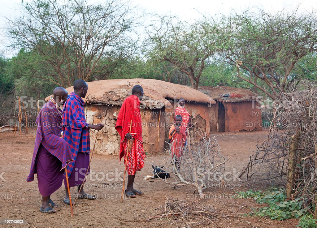 Maasai village with old men and a child stock photo