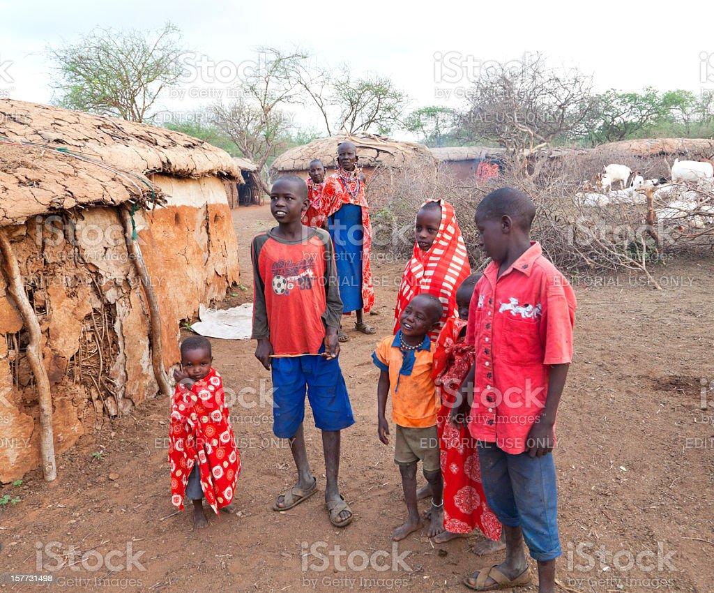 Maasai village with women and children. stock photo