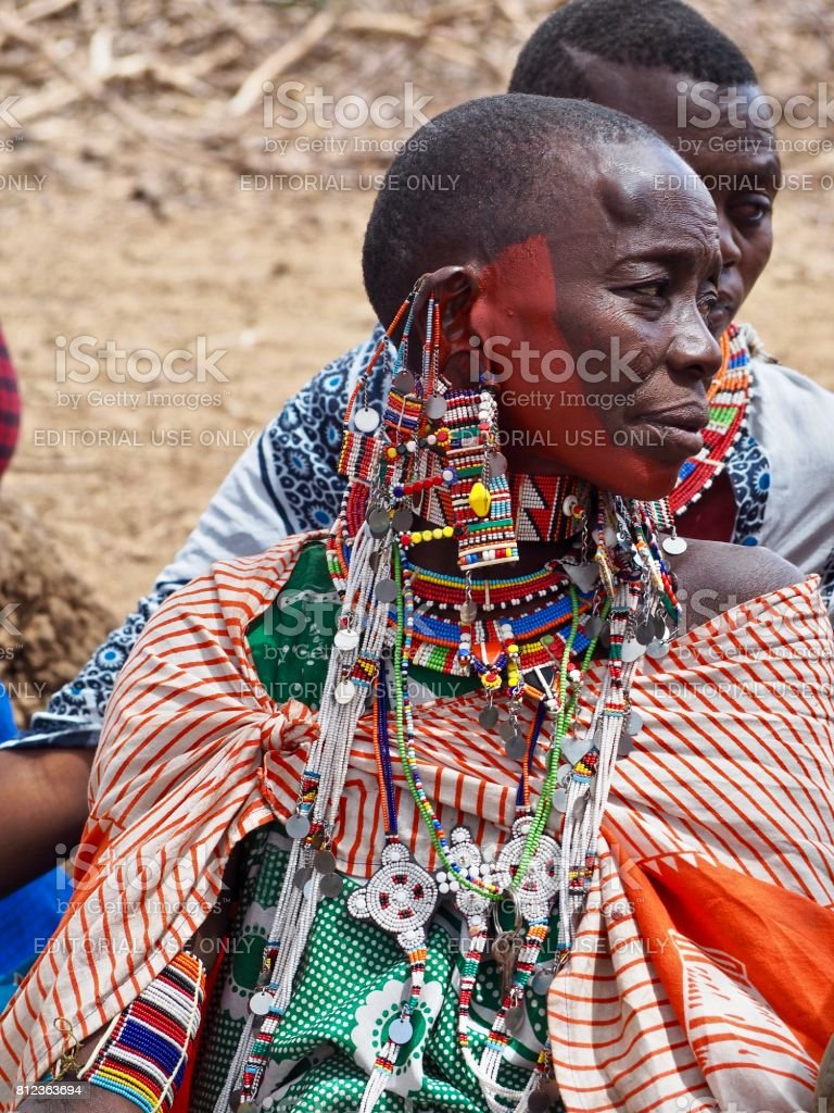 Maasai warrior mother in traditional dress from Amboseli in Kenya stock photo