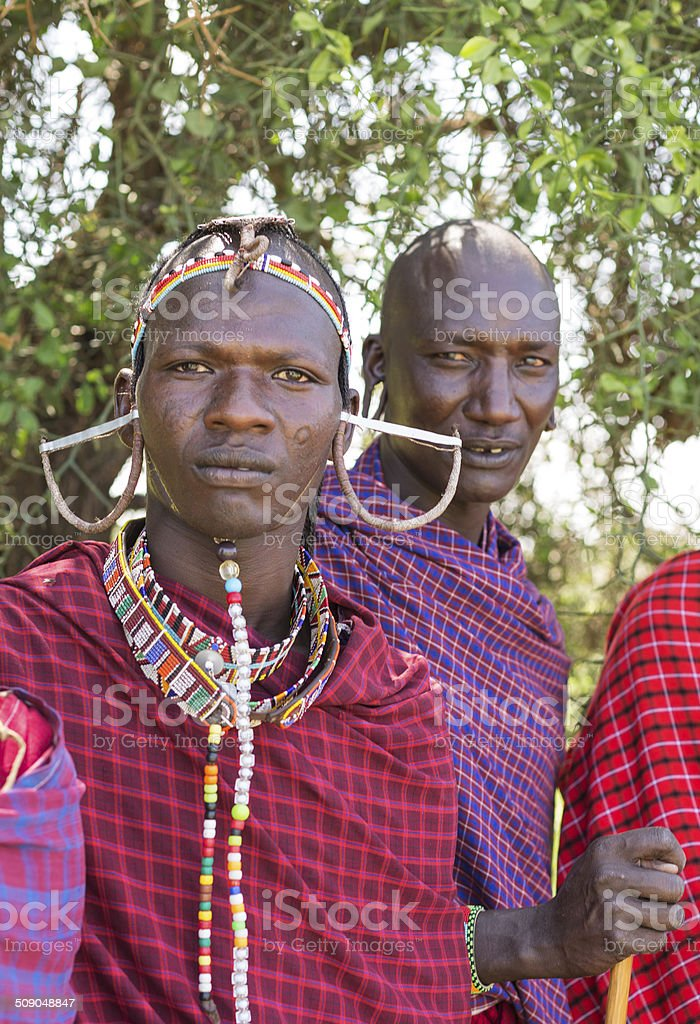 Maasai warrior (moran) with elder in the background. stock photo