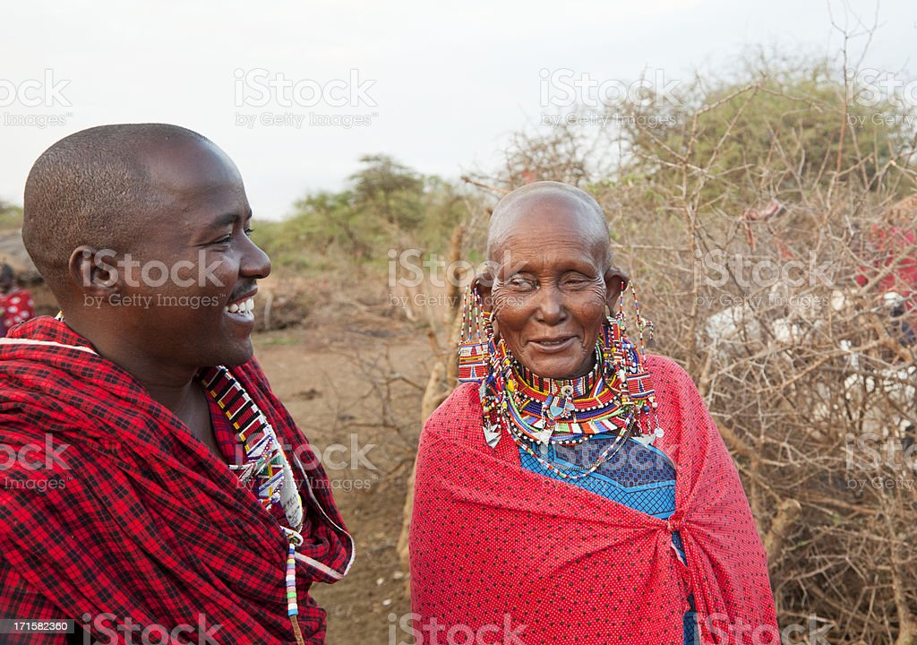 Maasai warrior with old female relative royalty-free stock photo