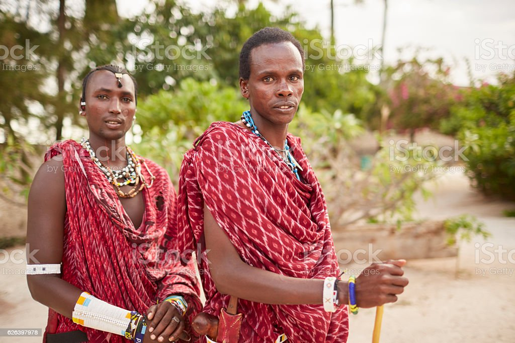 Maasai warriors portrait looking at camera. stock photo