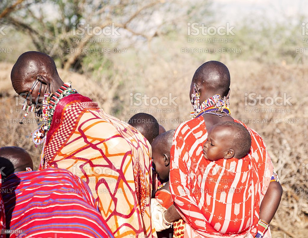 Maasai women in Kenya with children on the back stock photo