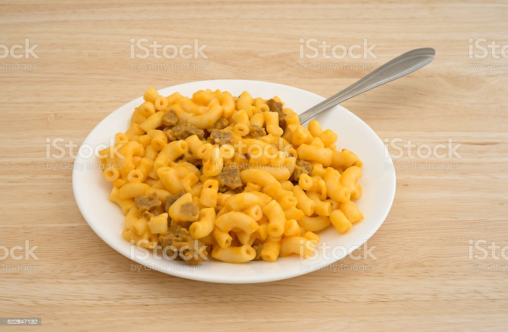 Mac and cheese with burger on plate with fork stock photo