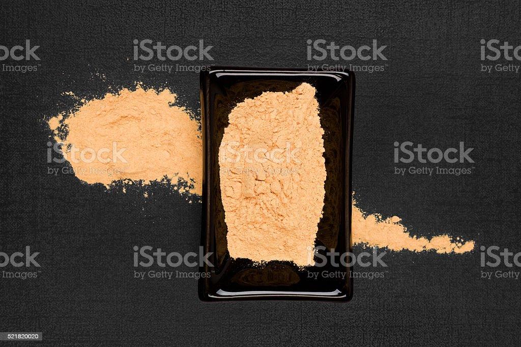 Maca powder on black background. stock photo