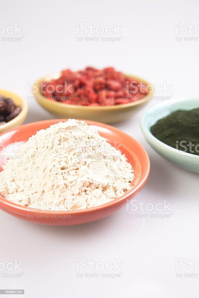 Maca powder, spirulina, goji berries, cacao royalty-free stock photo