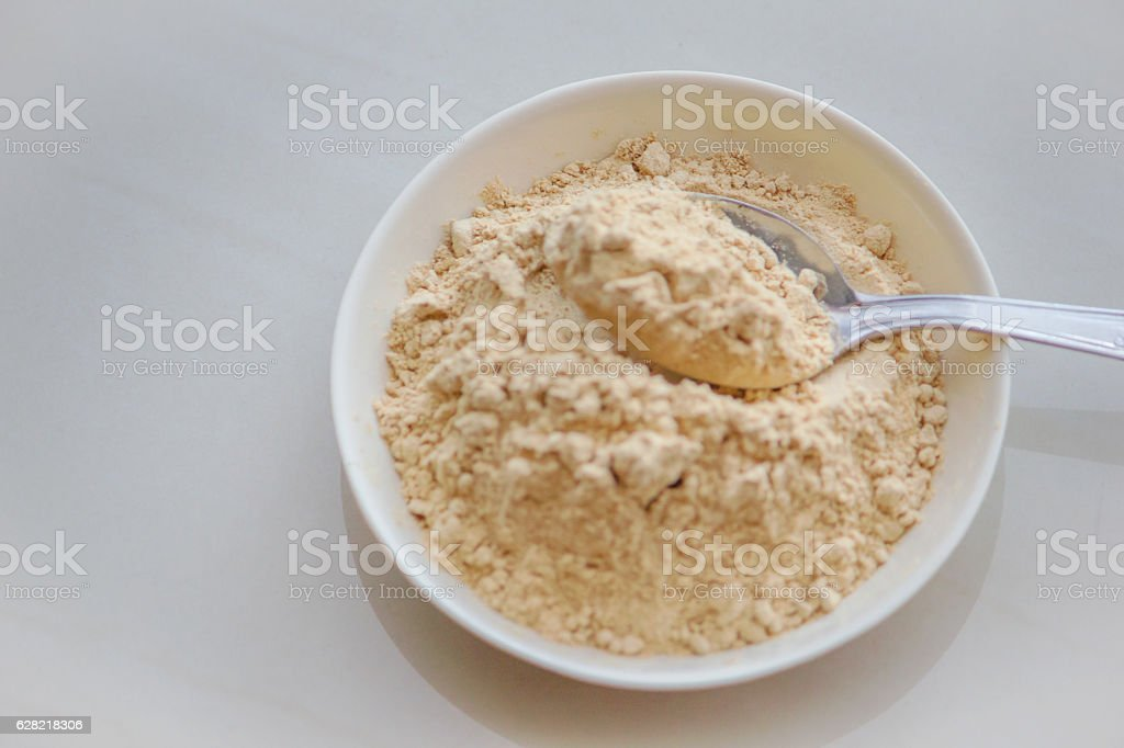 Maca root powder serving size stock photo