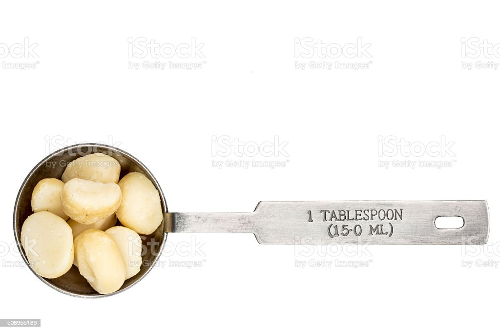 macadamia nuts in a tablespoon stock photo