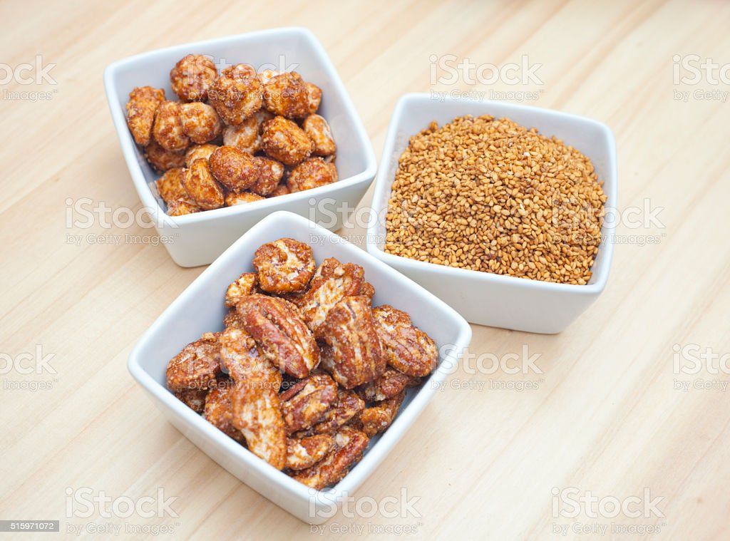 Macadamia, pecan nuts and sesame coated in sugar. stock photo