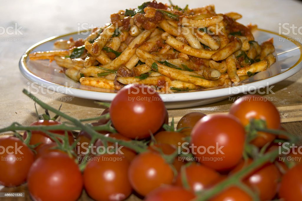 macaroni at the sauce stock photo
