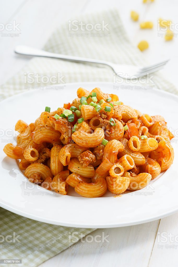 macaroni pasta in tomato sauce with chop meat stock photo