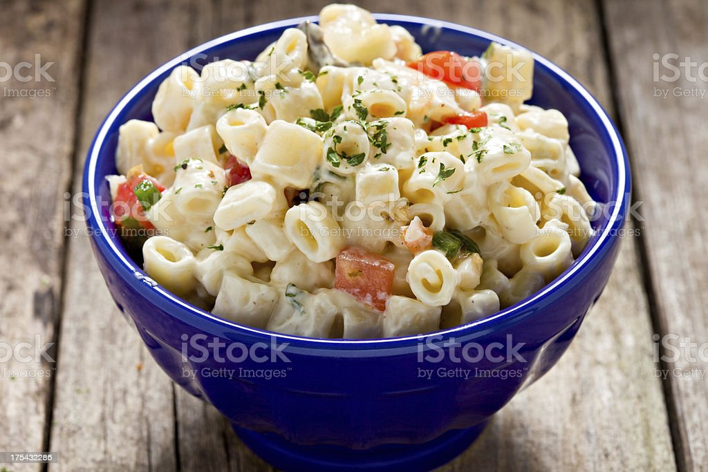 Macaroni Salad In A Blue Bowl stock photo