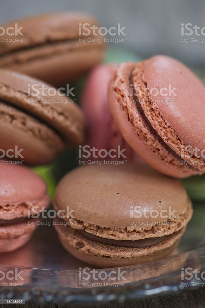 Macaroon pile on vintage silver plate. royalty-free stock photo