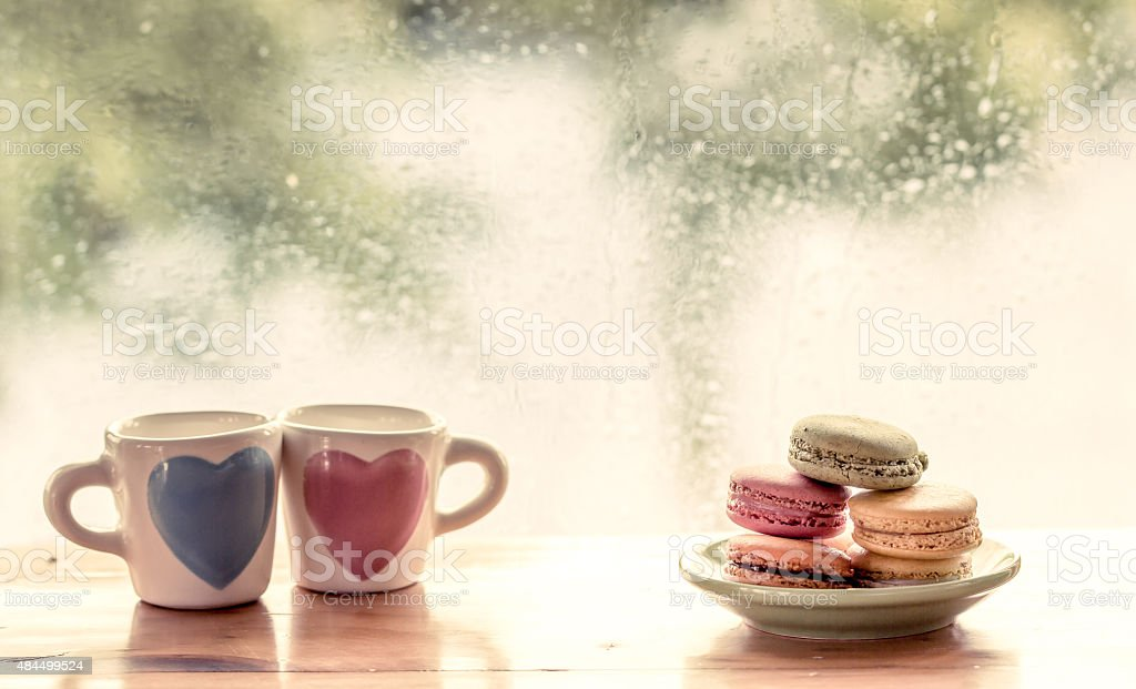 macaroon with lovely glass on rainy day window background stock photo