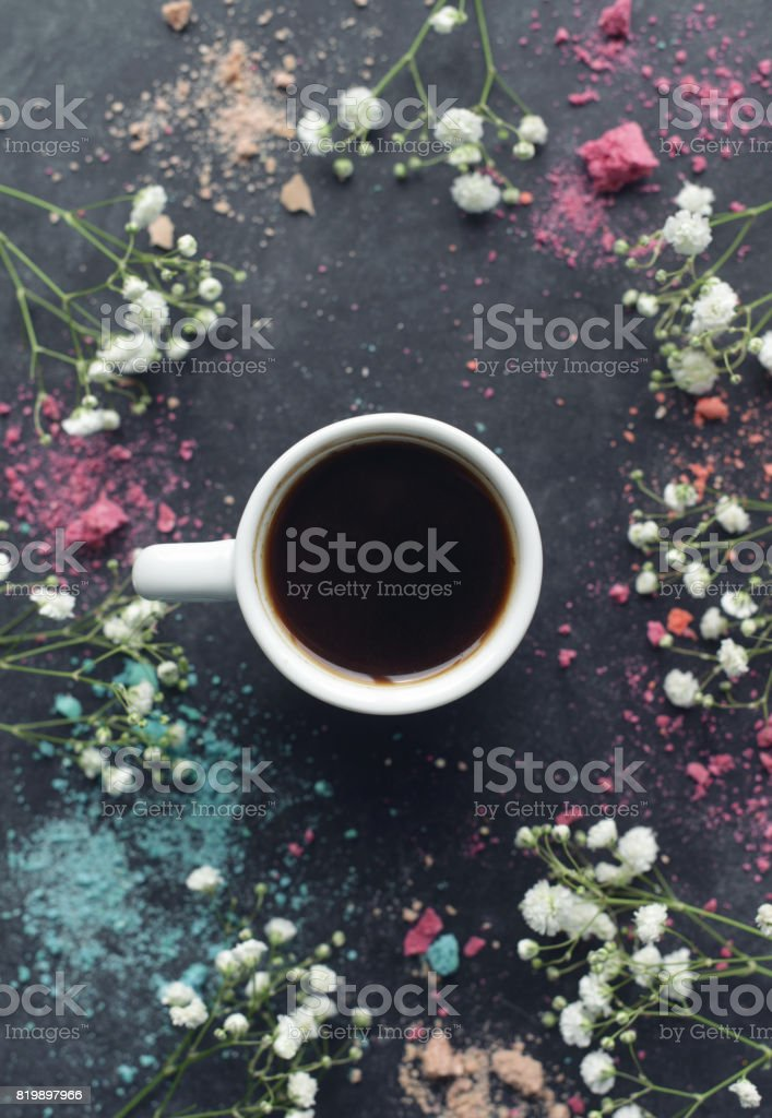 Macaroons and coffee and gift on a black background stock photo