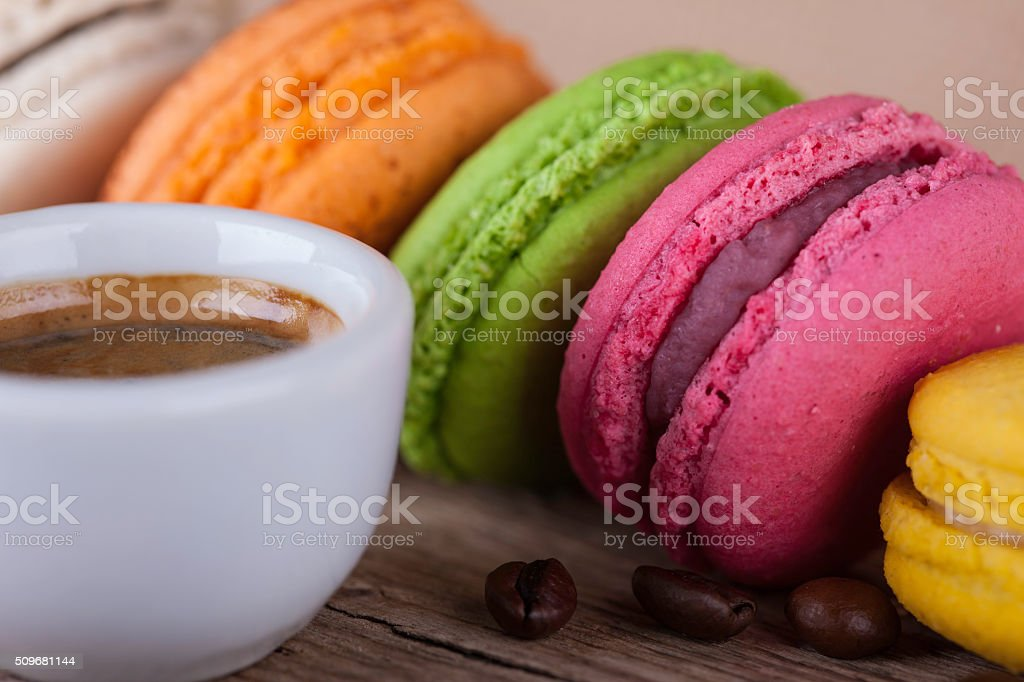 macaroons and cup coffee vintage side view background stock photo