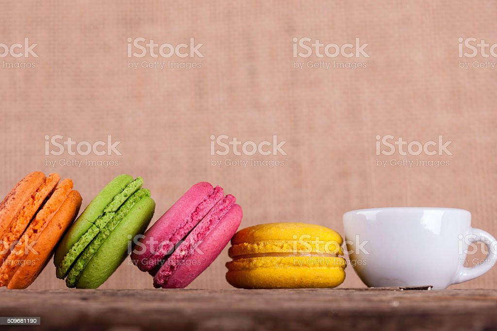 macaroons and cup coffee wooden board vintage background side view stock photo