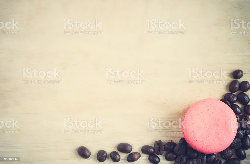 Macaroons and roasted coffee on stock photo