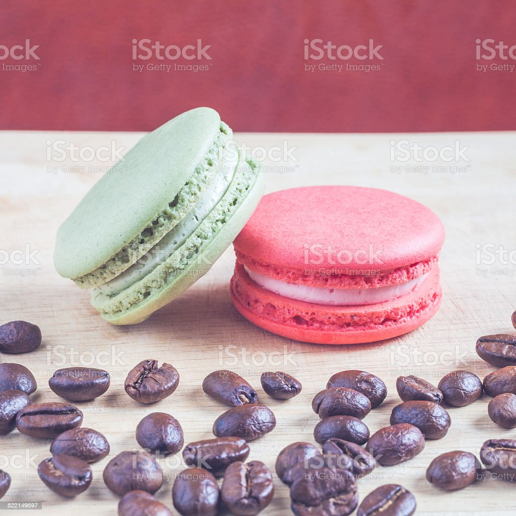 Macaroons and roasted coffee stock photo