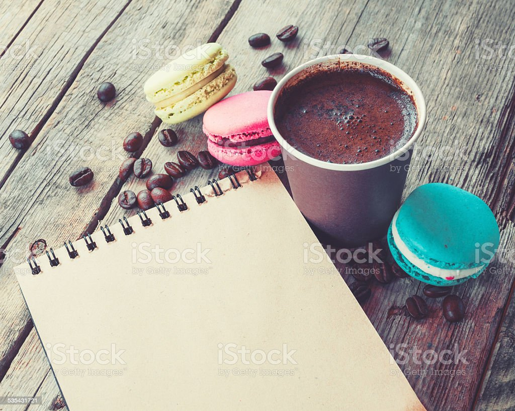 Macaroons cookies, espresso coffee cup and sketch book stock photo