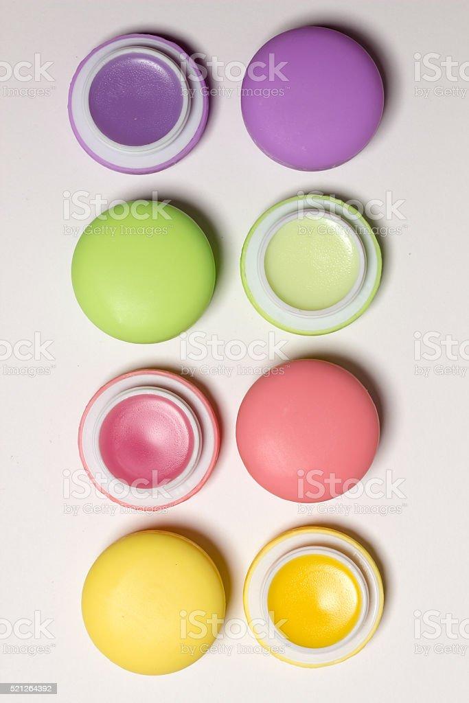 macaroons, lip balms,white background, isolated cosmetic photo stock photo