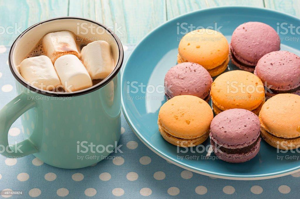 macaroons on blue ceramic plate stock photo