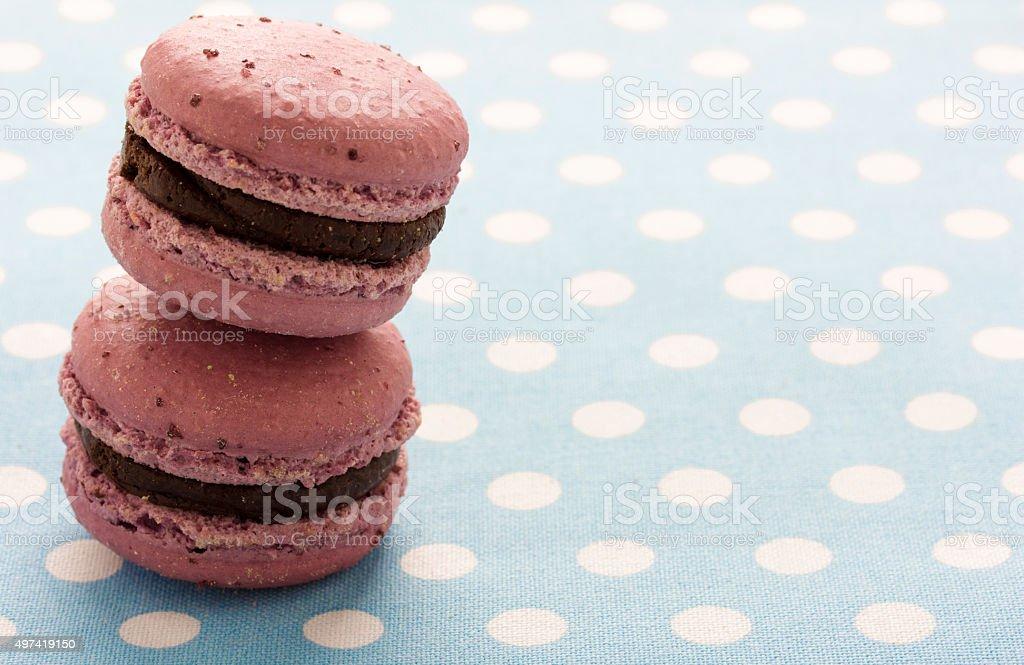 macaroons on polka-dot tablecloth stock photo