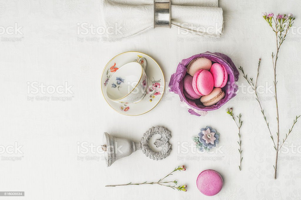 Macaroons with flowers and decorations top view stock photo