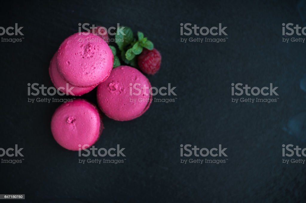macaroons with raspberries stock photo