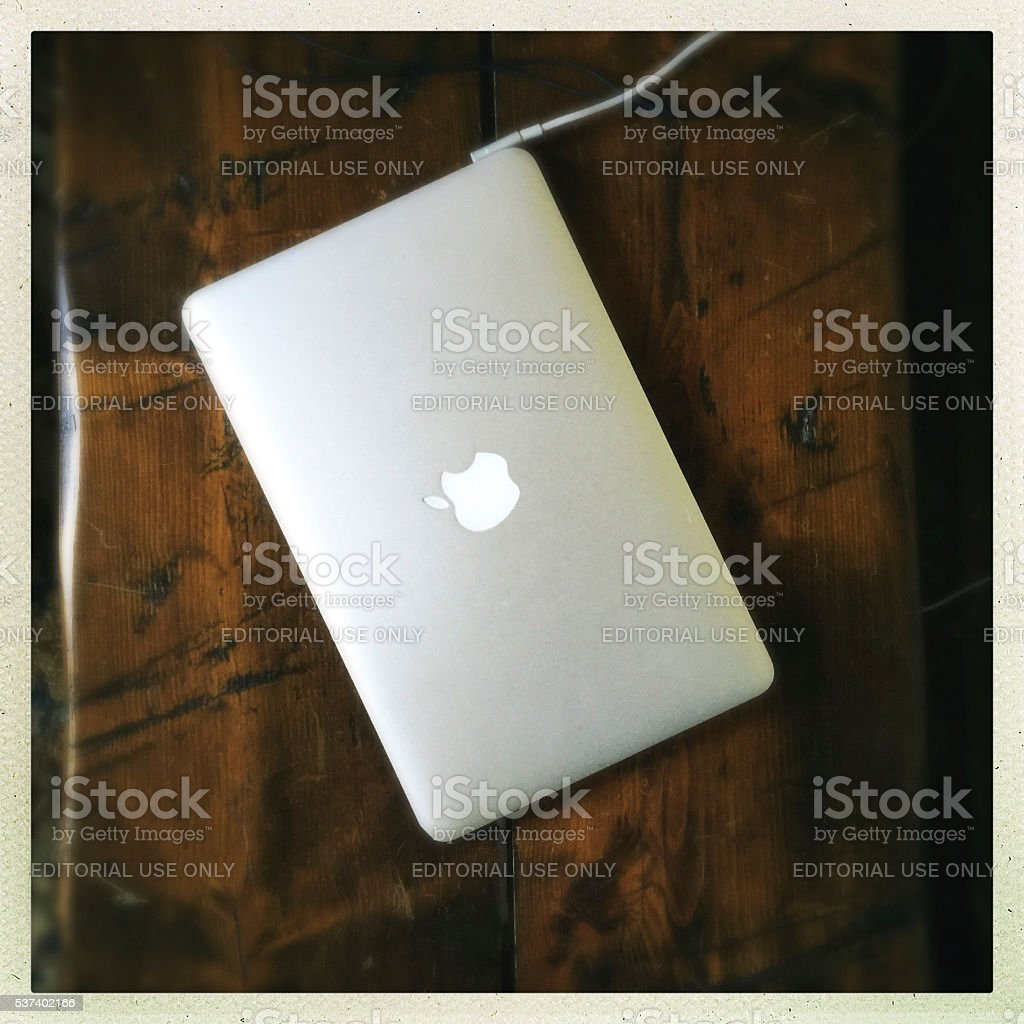 Macbook Air Computer on Wood Table stock photo