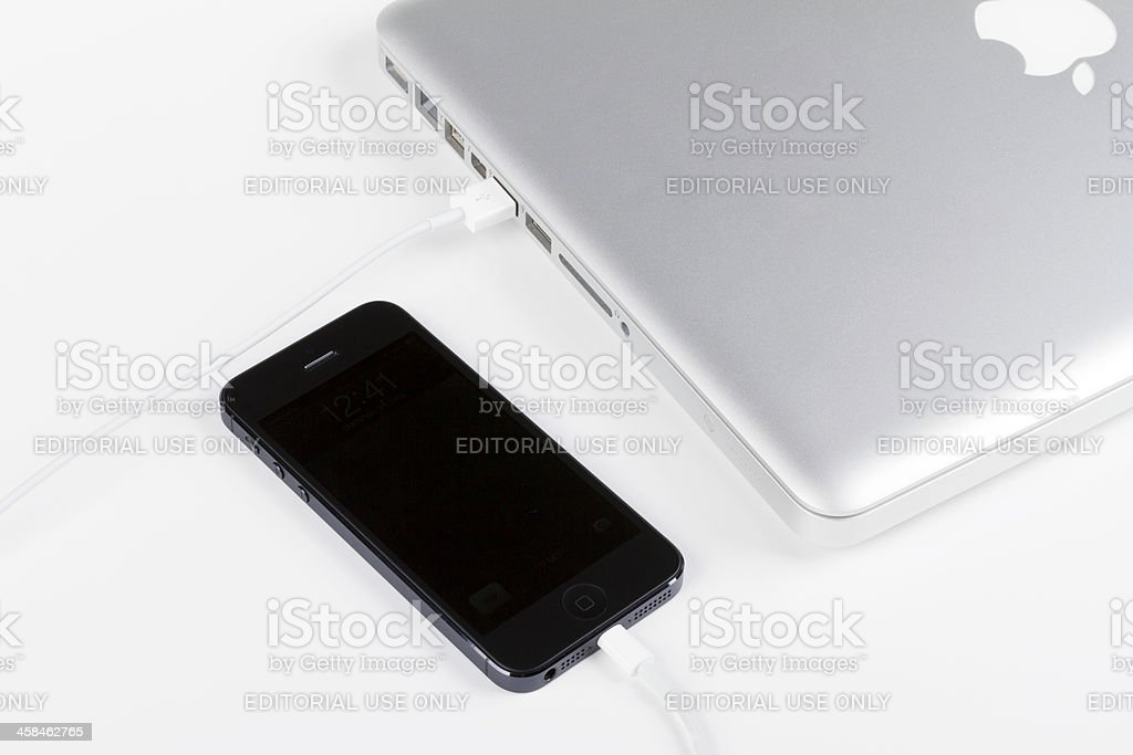 Macbook pro and iphone 5 stock photo