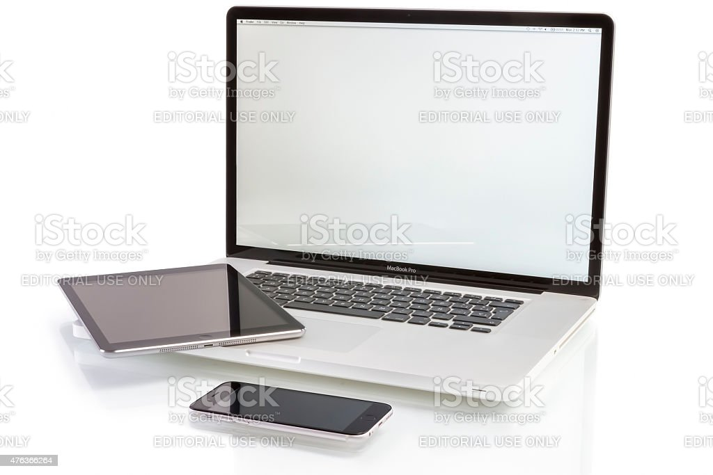 Macbook Pro iPad Air and iPhone 6 stock photo