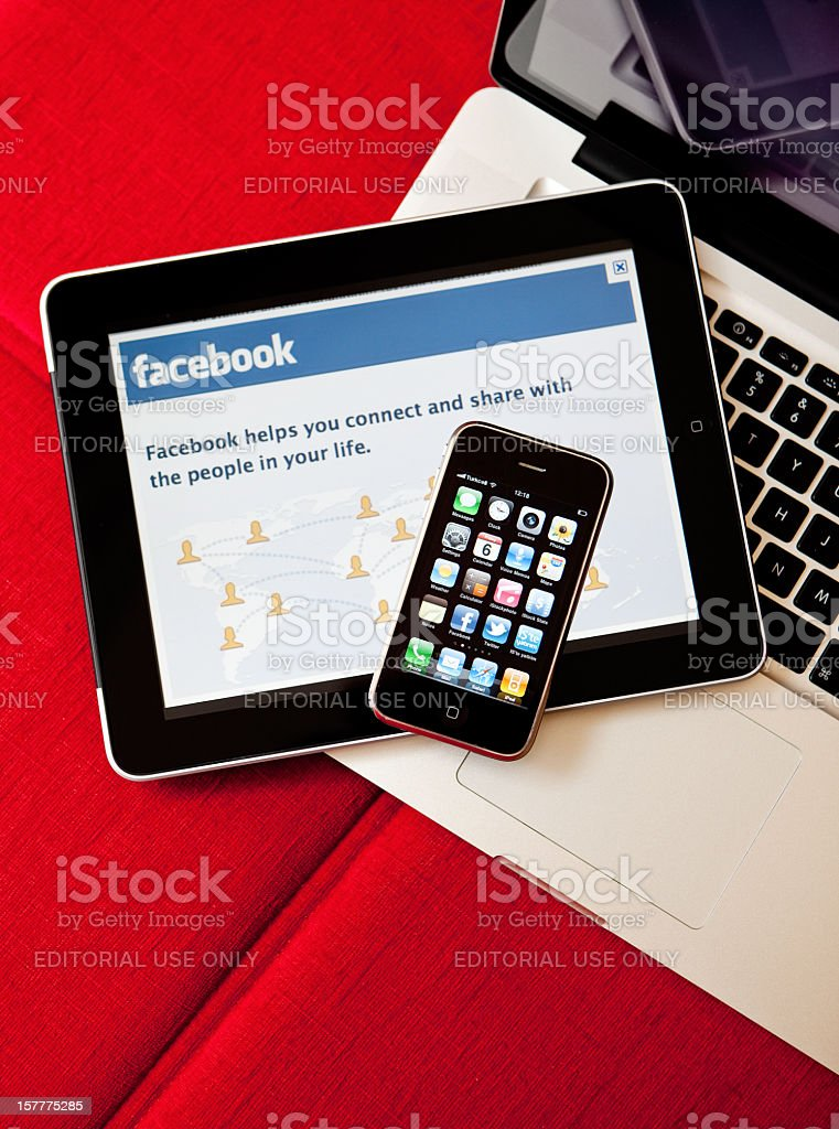 MacBook Pro iPad and iPhone together on the sofa royalty-free stock photo