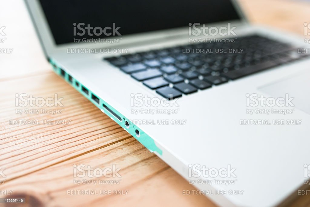 Macbook Pro Laptop on the desk stock photo