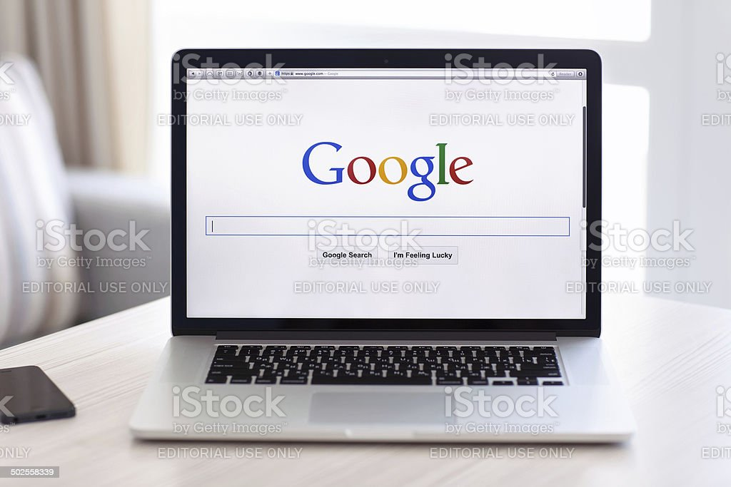 MacBook Pro Retina with Google home page on the screen stock photo
