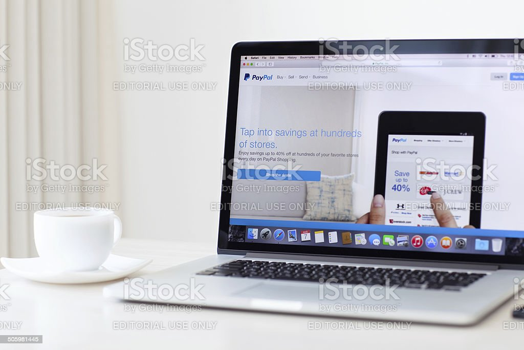 MacBook Pro Retina with PayPal home page on the screen stock photo