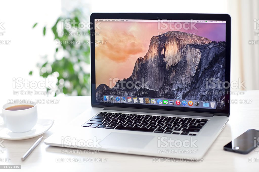 MacBook Pro with OS X Yosemite is on the table stock photo