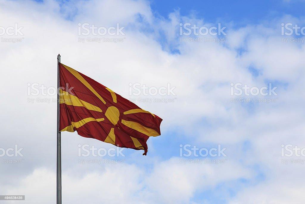 Macedonia Flag on cloudy sky stock photo
