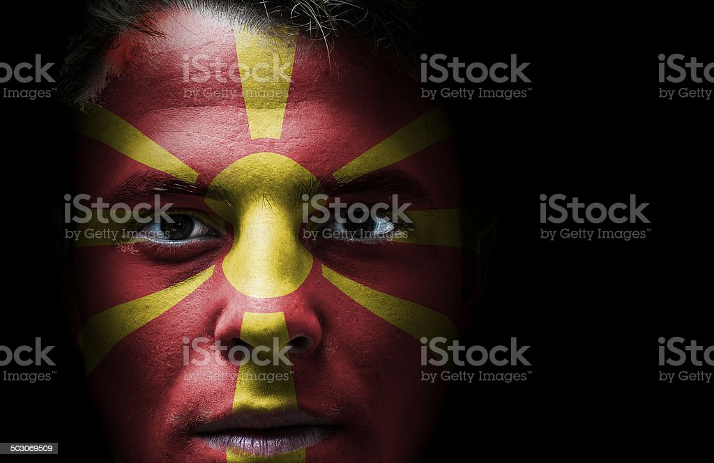 Macedonian flag on face stock photo